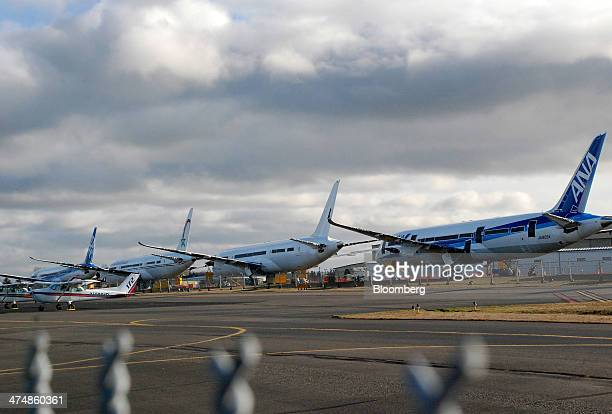17000 pound counterweights hang from the wings of a Boeing Co 787 Dreamliners at Paine Field in Everett Washington US on Friday Feb 14 2014 Boeing Co...