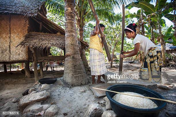 Pounding rice to remove the husks
