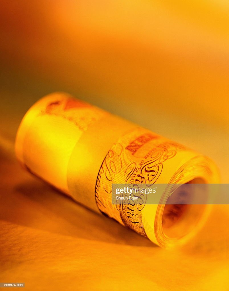 Pounds Sterling, close-up of roll of ten pound banknotes