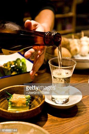 Pour the liquor : Stock Photo