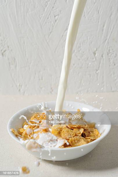 Pour the milk into cereal