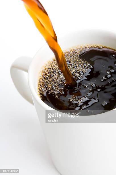 Pouring a Fresh Cup of Brewed Coffee (Isolated)