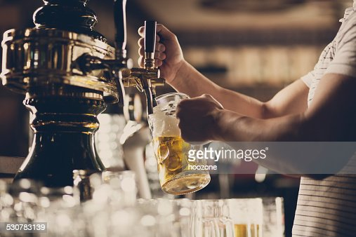 Pouring a glass of beer.