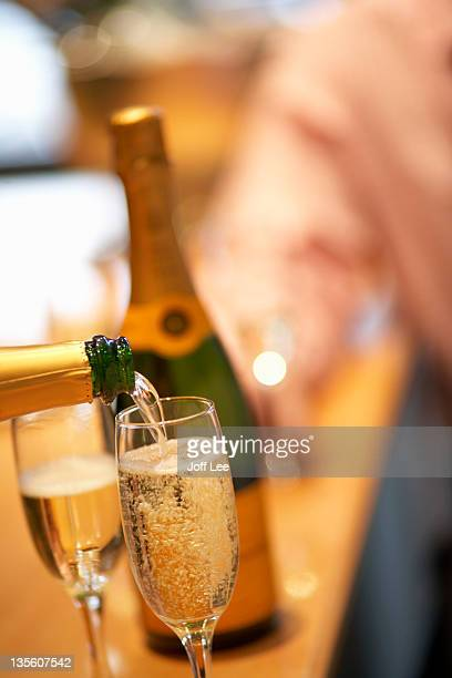 Pouring a glass of champagne