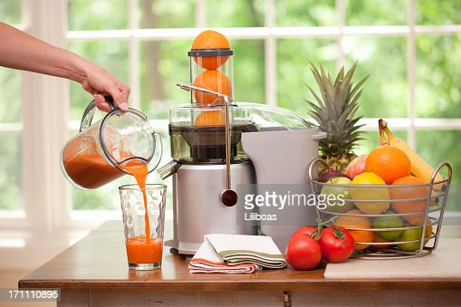 Pouring a Glass of Fresh Blended Organic Juice