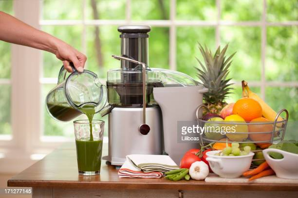 Pouring a Glass of  Fresh Organic Green Juice