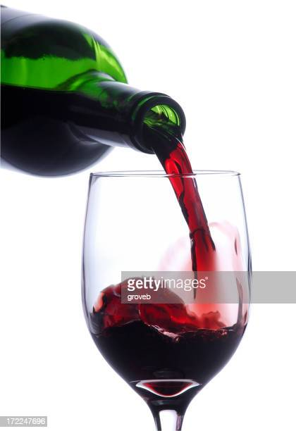 Pouring a glass of wine w/clipping path