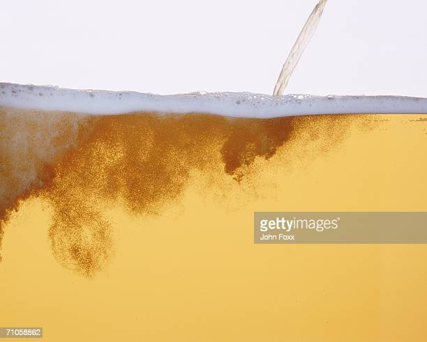 Pouring beer, close-up