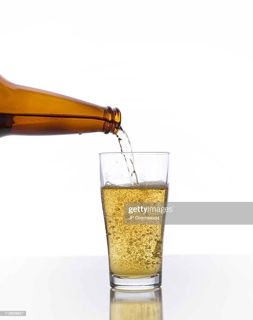 Pouring Beer In Glass : Stock Photo