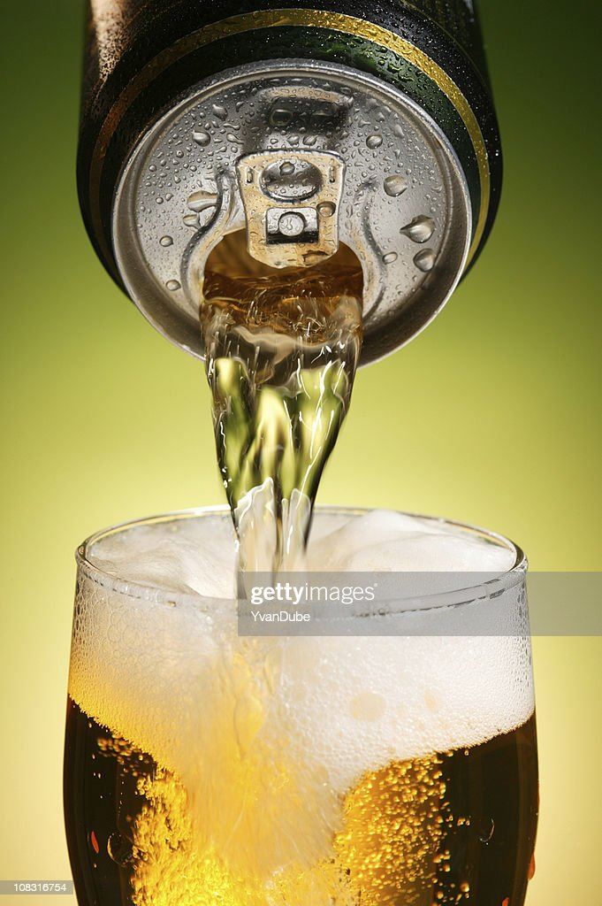 pouring beer with drink can : Stock Photo