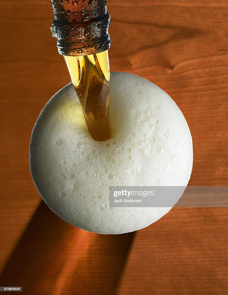 Pouring beer with foam