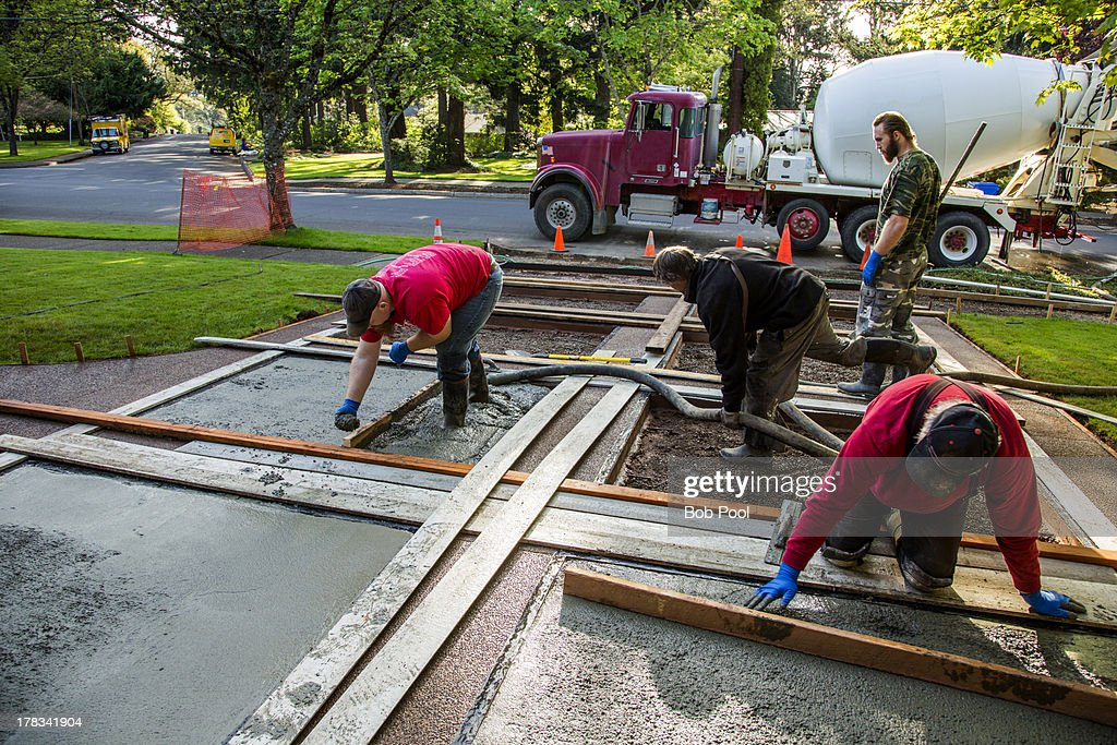 Pouring concrete in a driveway stock photo getty images for Pouring concrete driveway