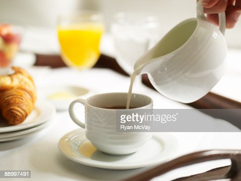 Pouring Cream Into Coffee Stock Photo | Getty Images