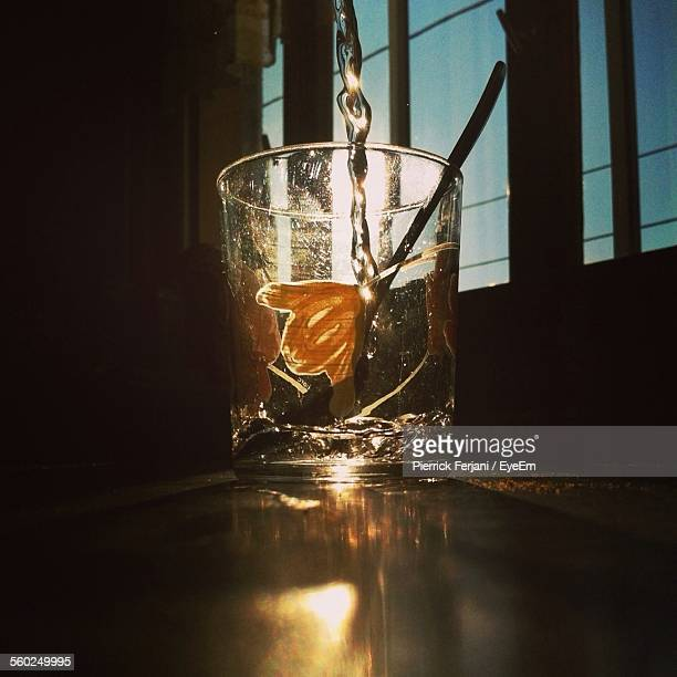 Pouring Drink Into Glass In Sunlight