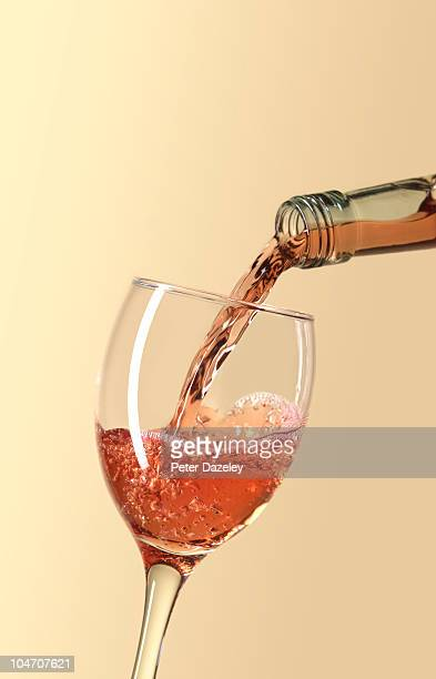 Pouring glass of rose wine with copy space