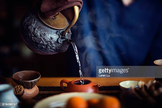 Pouring hot water into Chinese tea pot