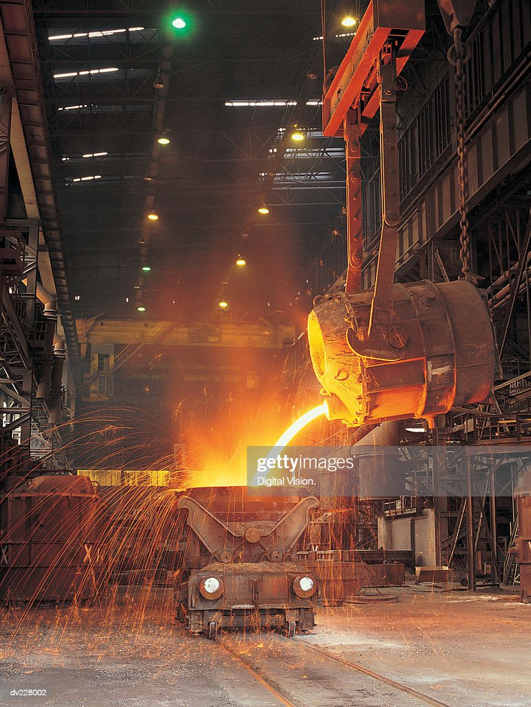 Pouring molten steel into tank : Stock Photo