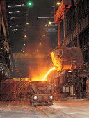 Pouring molten steel into tank