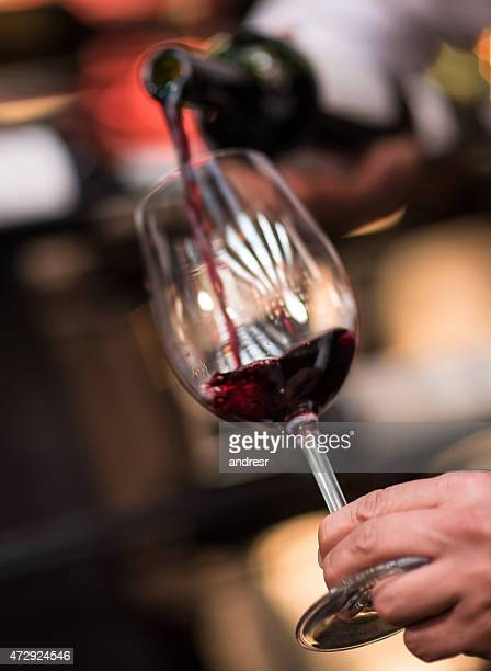 Pouring red wine at a winetaste