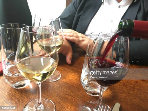 pouring red wine in a Paris restaurant