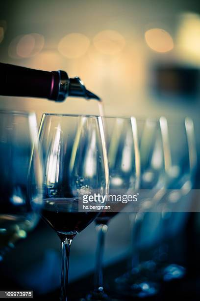 Pouring Red Wine into Glasses