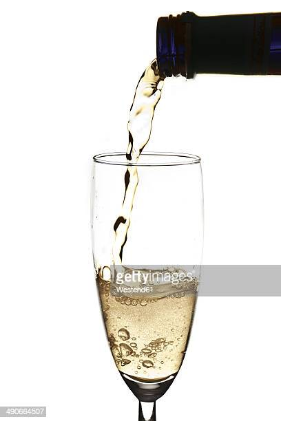 Pouring sparkling wine into champagne flute