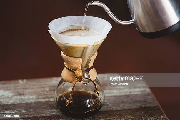 Pouring water into filter coffee maker