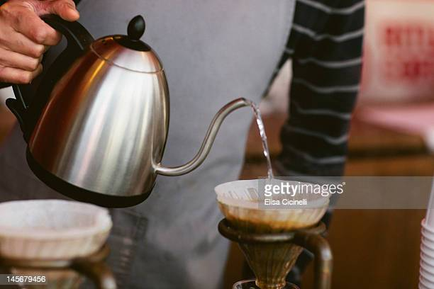 Pouring water over filtered coffee