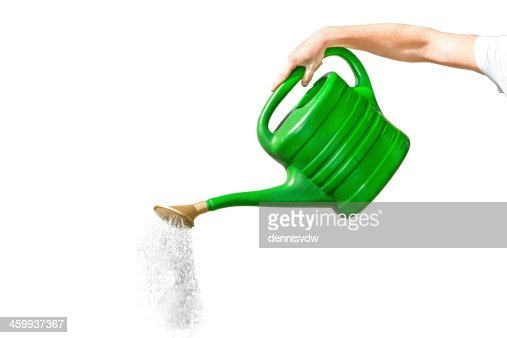 pouring watering can stock photo thinkstock