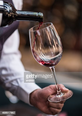 Pouring wine at a winetaste