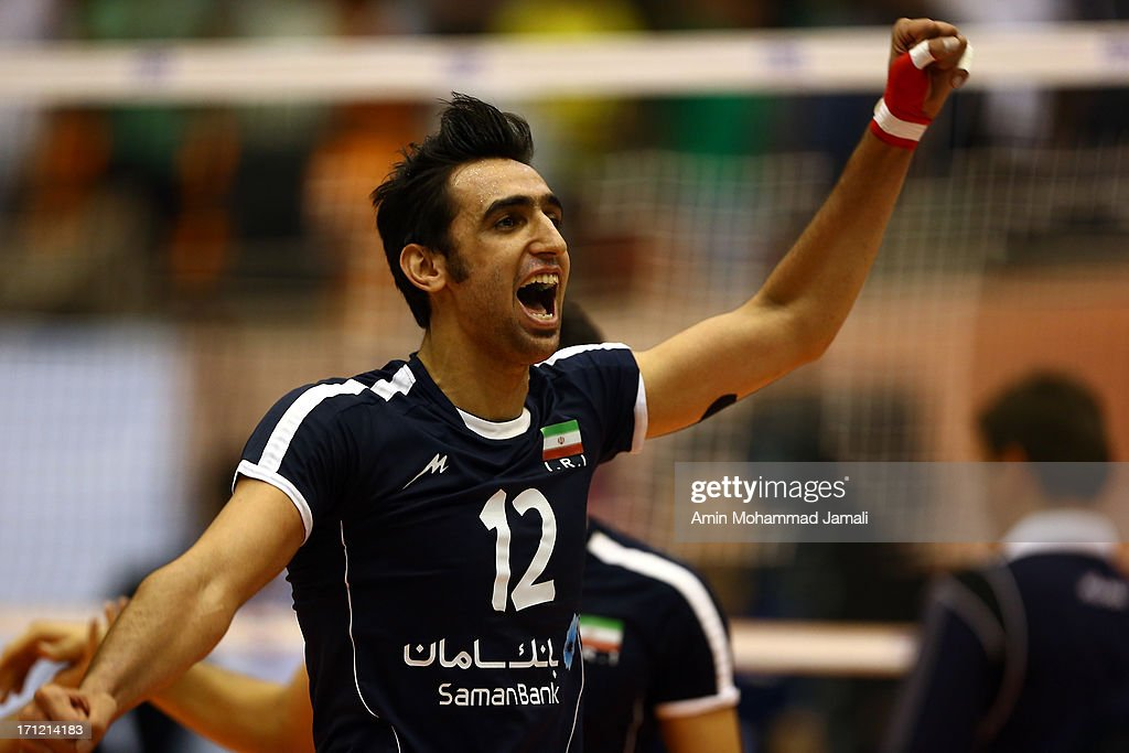 Pourya Fayazi Damnabi celebrates during the Volleyball World League match between Iran and Serbia on June 23, 2013 in Tehran, Iran Azadi Complex.