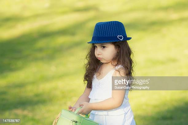 Pouting girl in blue-striped gat