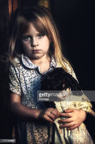 Poverty Stricken Little Girl Looking Sad