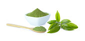 Powder green tea in cup with wooden spoon and green tea leaf on white background and clipping path