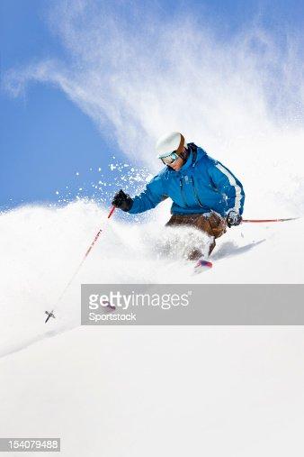 Powder Skiing Against Colorado Blue Sky : Stock Photo