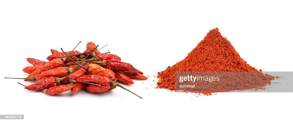 Powdered dried red pepper on white background : Stock Photo