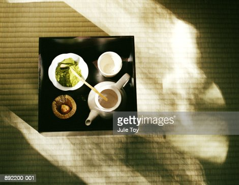 Powdered green tea, tea pot and cup set up on tray for tea ceremony : Stock Photo