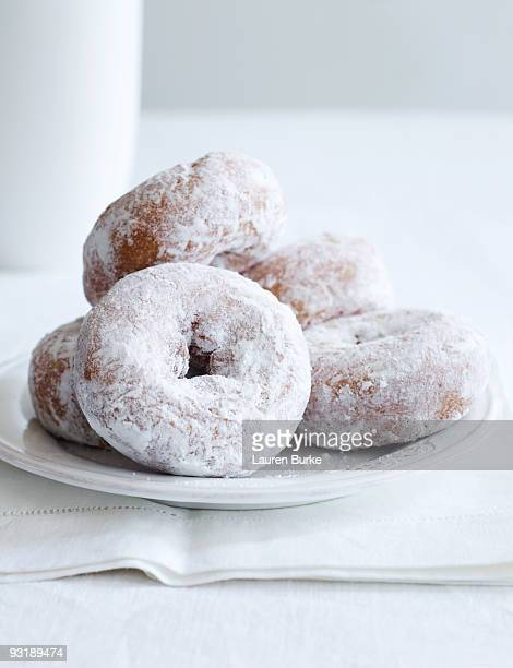 Powdered Sugar Donuts on White Tablecloth