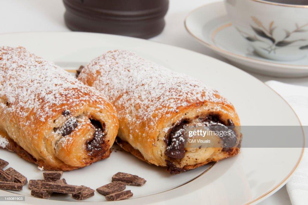 Powdered sugar on chocolate croissants : Stock Photo