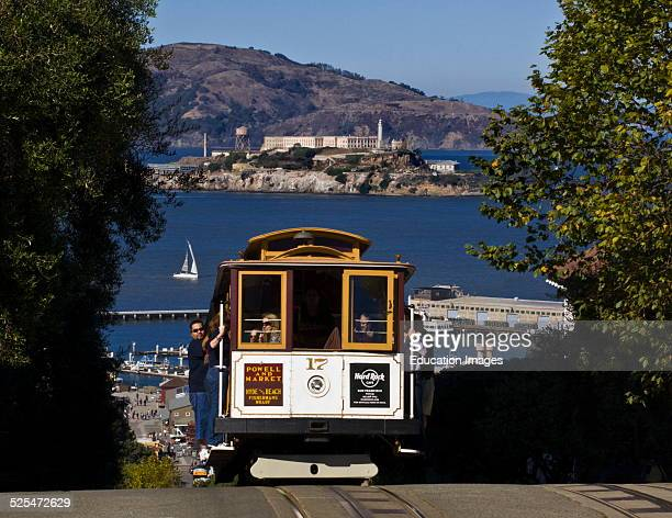 A Powell And Market Cable Car With A View Of Alcatraz Island San Francisco California