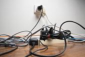 Overloaded power board in home office