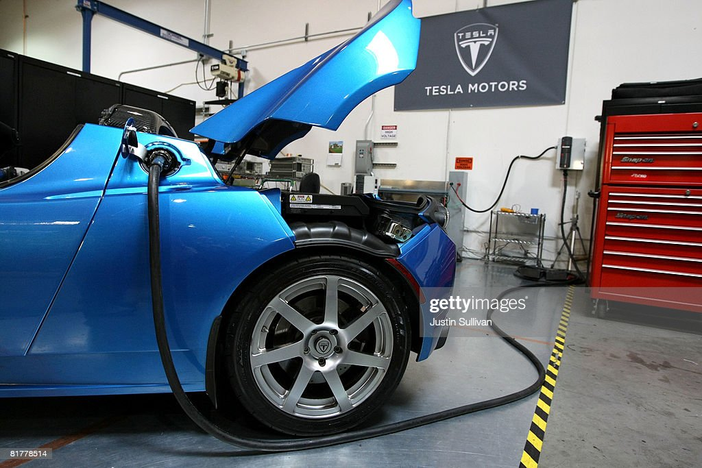 A power cable is seen plugged into a Tesla Roadster after a news conference with California governor Arnold Schwarzenegger June 30, 2008 at Tesla Motors in San Carlos, California. Governor Schwarzenegger announced that electric car company Tesla Motors will build a new manufacturing facility in California to manufacture its all-electric Tesla Roadster. The $109,000 2009 Tesla Roadster zero emissions vehicle is capable of traveling nearly 250 miles on a single charge and is capable of going 0-60 miles per hour in 3.9 seconds.