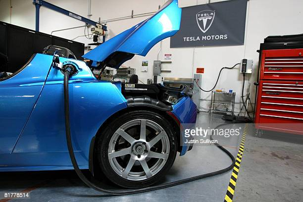 A power cable is seen plugged into a Tesla Roadster after a news conference with California governor Arnold Schwarzenegger June 30 2008 at Tesla...
