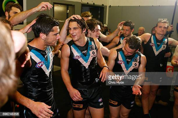 Power celebrate winning the round 23 AFL match between the Gold Coast Suns and the Port Adelaide Power at Metricon Stadium on August 27 2016 in Gold...