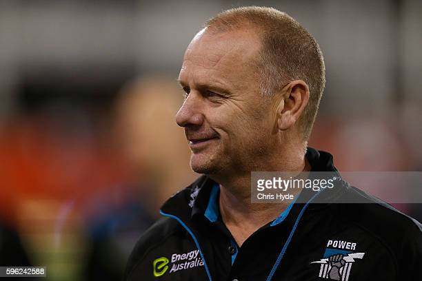 Power coach Ken Hinkley looks on during the round 23 AFL match between the Gold Coast Suns and the Port Adelaide Power at Metricon Stadium on August...