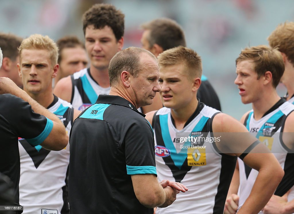 Power coach Ken Hinkley speaks to his team at three-quarter time during the round one AFL match between the Melbourne Demons and Port Adelaide Power at the Melbourne Cricket Ground on March 31, 2013 in Melbourne, Australia.
