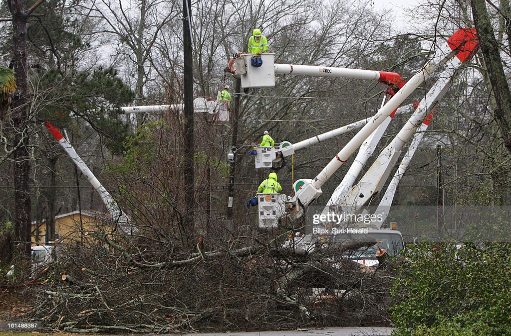 Power company crews work to repair damaged transmission lines in Hattiesburg, Mississippi on Monday, February 11, 2013. An EF-4 tornado hit the area according to a preliminary report from the National Weather Service in Jackson. Sixty-three people were injured in the storm.