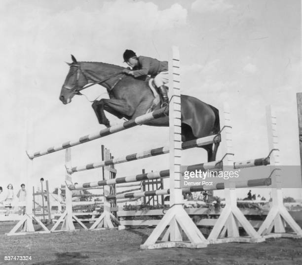Power Demonstration Nimble and rider Mrs Wilson Dennehy clear triplebar fence at 5 ft 6 in for a second place in puissance strength test at US...