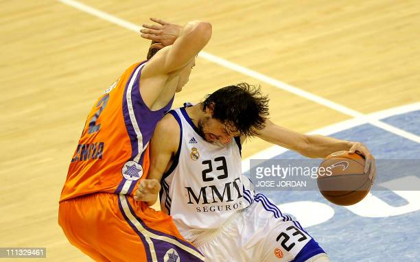 Power Elec Valencia's Ukrainian forward Serhiy Lishchuk vies for the ball Real Madrid's guard Sergio Llull during the Euroleague basketball match...