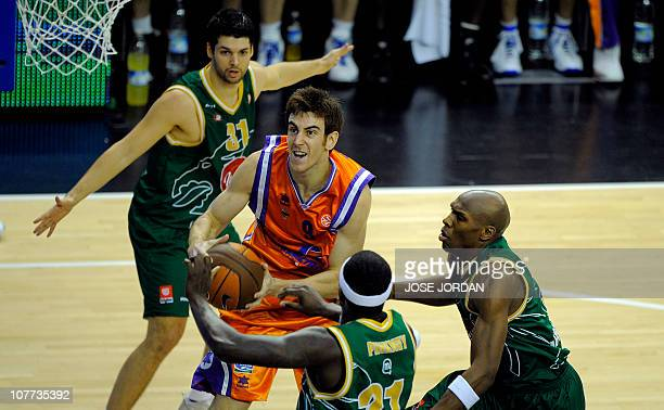Power Electronics Valencia´s Victor Claver vies with Union Olimpija Slovenian Saso Ozblt US kevinn Pinkeny and US kenny Gregory during the Euroleague...